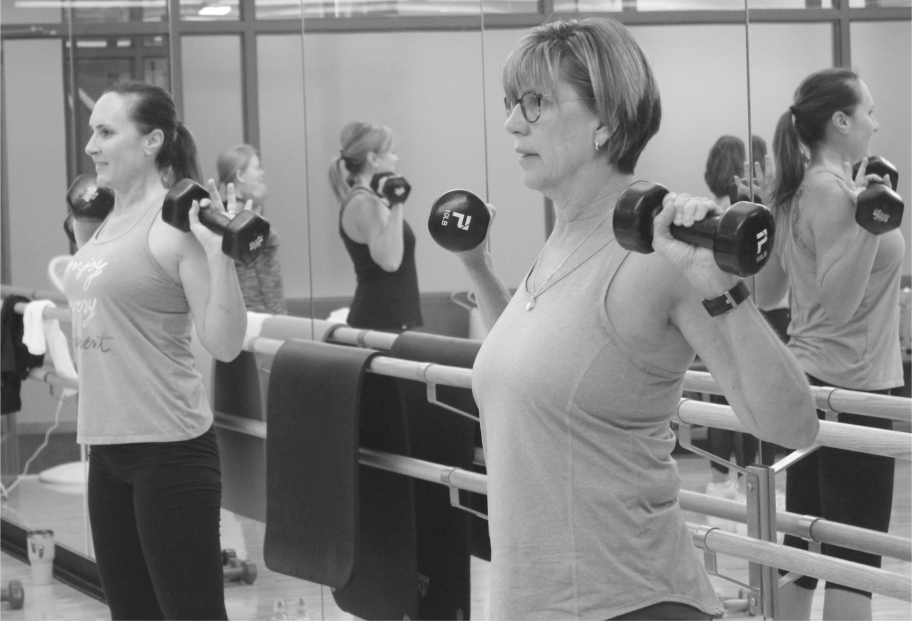 Two Women Holding Dumbbells