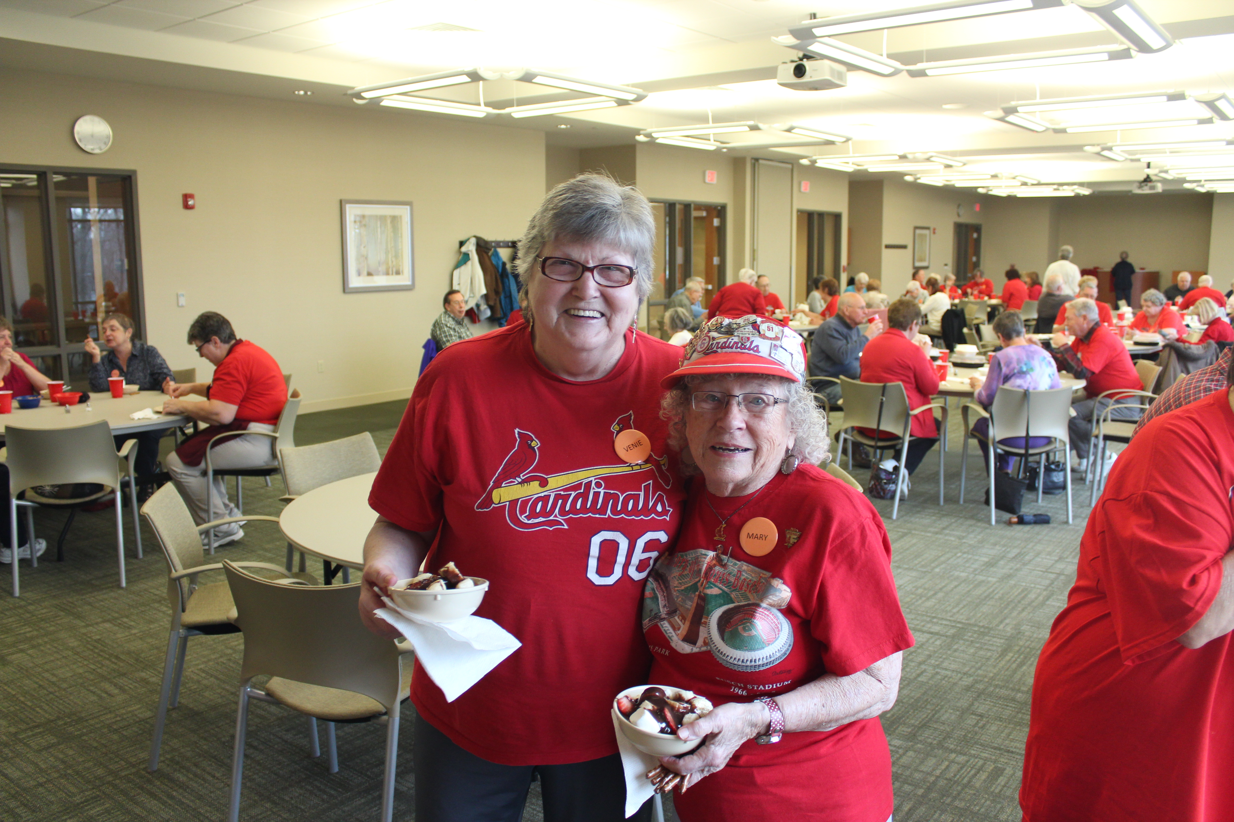 Two Seniors Wearing Cardinals T-Shirts